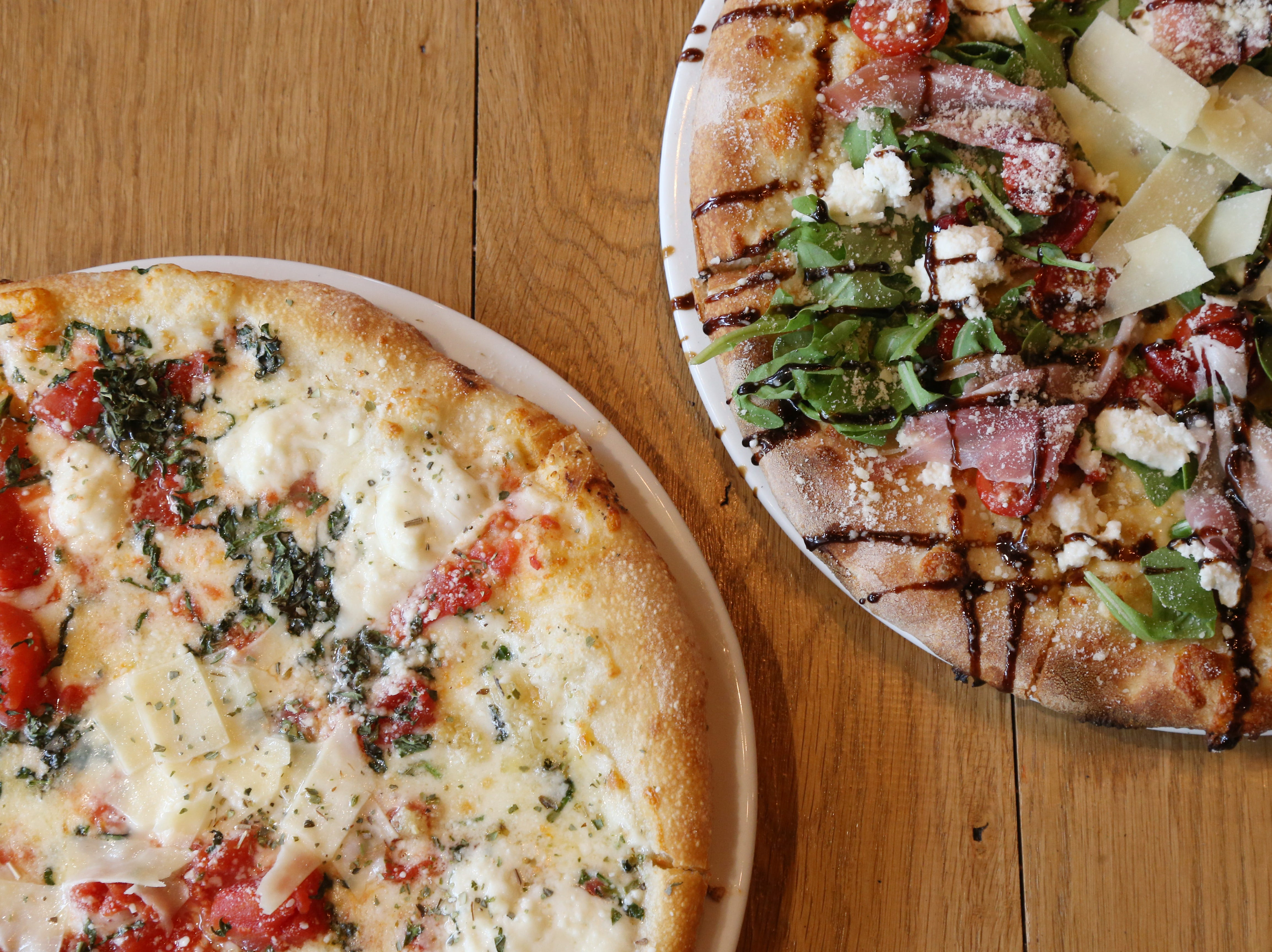 From left, a Nonna Romana and an Antonella brick oven pie at Pizza Union in the Town of Newburg on August 31, 2018.