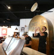 Pizzaiolos, from left, Yanni Paximadakis and Kevin Mahan prepare dough at Pizza Union in the Town of Newburgh on August 31, 2018.