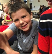 Sean Burlingame, 7, poses for a photo.