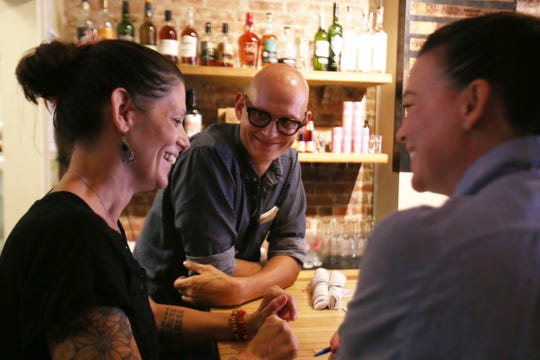 Owner Phillipe Pierre speaks with, from left, waitress Vanessa Budetti and general manager Sterling Knight at Ms. Fairfax on Liberty Street in Newburgh on August 30, 2018.