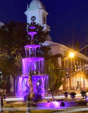 Chambersburg's Memorial Fountain, lit in purple for Recovery Month in September 2018.