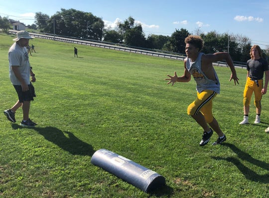 Eastern York wide receiver Demonte Martin runs through a drill run by head coach Josh Campbell. Martin has caught three touchdowns in Eastern's first two games, both wins, this season.