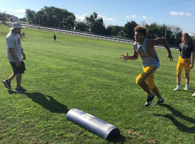 Eastern York wide receiver Demonte Martin runs through a drill run by head coach Josh Campbell earlier this season. Martin has caught 17 touchdowns this season.