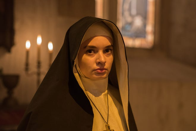 "Ingrid Bisu as Sister Oana in the film ""The Nun."" The movie is playing at Regal West Manchester Stadium 13 and Frank Theatre Queensgate Stadium 13,"
