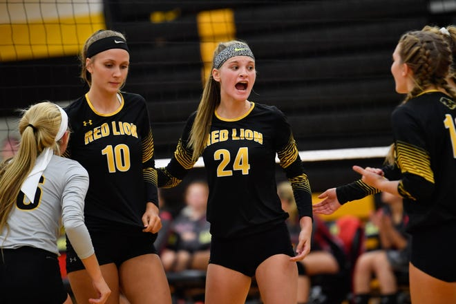 Maddie Grim (24) rallies her teammates before the next serve, Tuesday, September 4, 2018. Dover defeated Red Lion 3-1, at Red Lion High School.