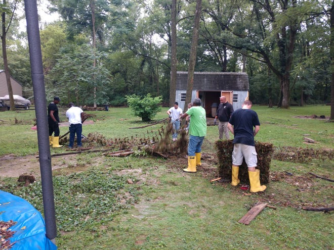 Inmates from York County Prison joined in the post-flood cleanup of the Hellam area on Sept. 1.