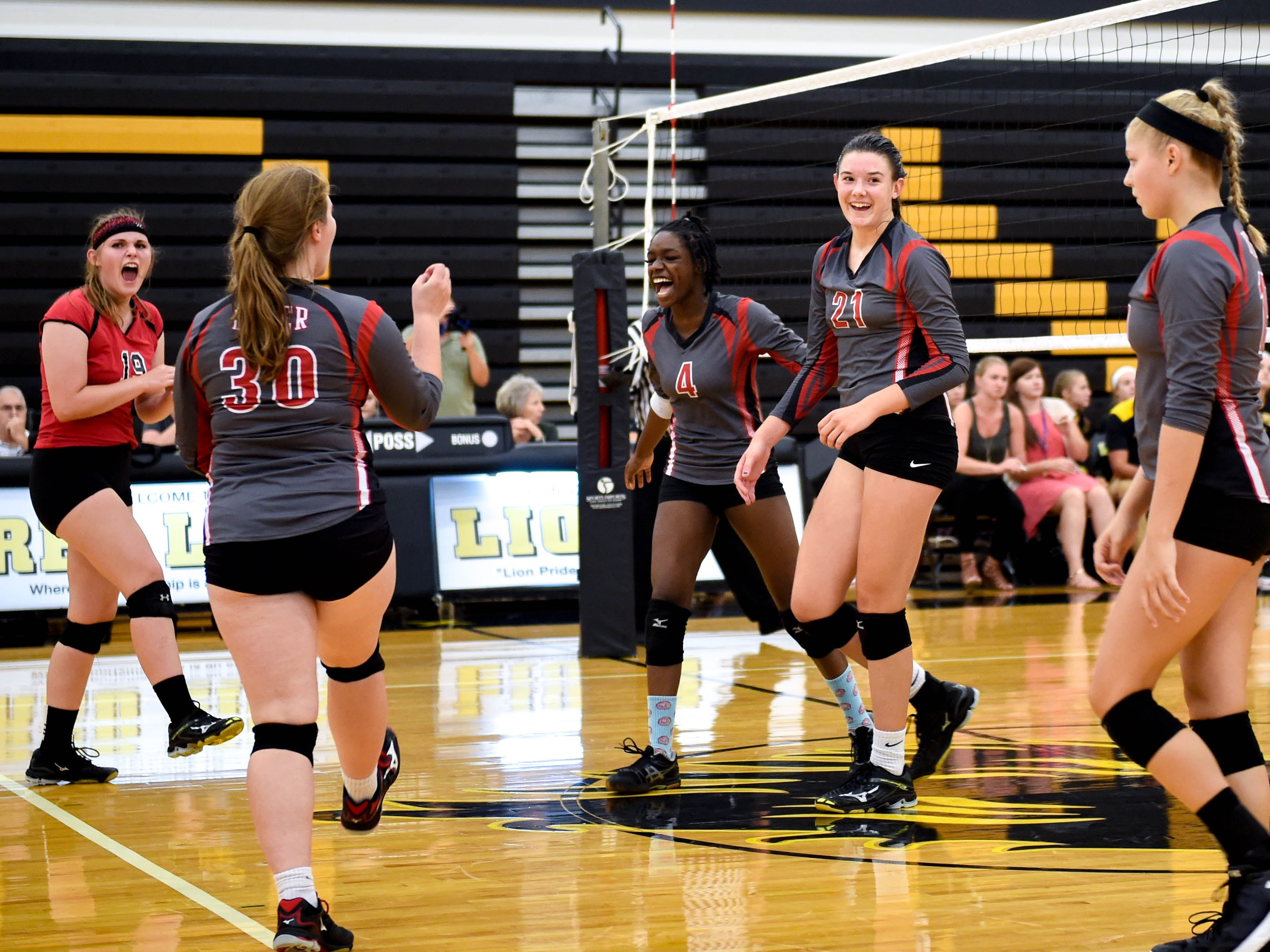 Dover celebrates the kill, Tuesday, September 4, 2018. Dover defeated Red Lion 3-1, at Red Lion High School.