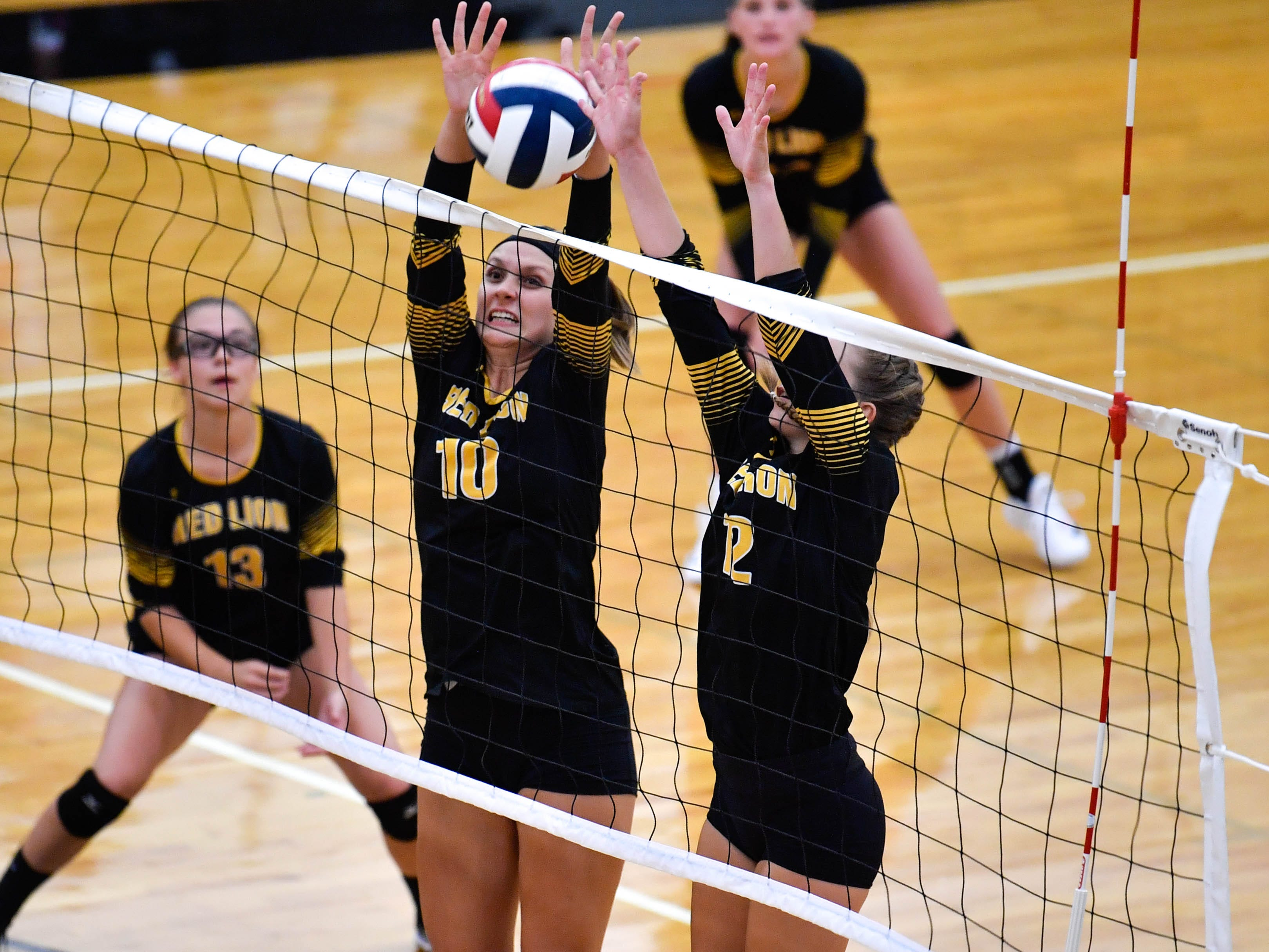 Red Lion's Julia Beiler (10) and Katie Thompson (12) block the spike, Tuesday, September 4, 2018. Dover defeated Red Lion 3-1, at Red Lion High School.