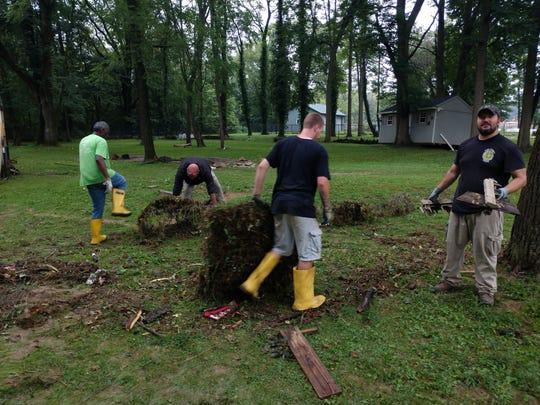 Work release inmates from York County Prison volunteered to help clear debris and damage from Hellam properties hit hard by the Aug. 31 flood.