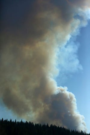 Large plumes of smoke fill the air above Northern California at Emigrant Gap west of Truckee where the North Fire began Monday, Sept. 3, 2018, in Grass Valley, Calif. The fire is moving at a rapid rate of spread with large air tankers on order as reported by The Union. (Elias Funez/The Union via AP)
