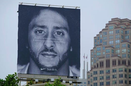 A large billboard showing Colin Kaepernick stands on top of the building housing the Nike store at Union Square Wednesday, Sept. 5, 2018, in San Francisco.