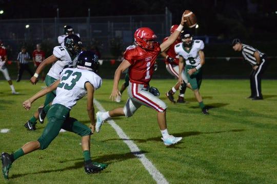 Wooster quarterback Jace Papke scores against Hug last week.