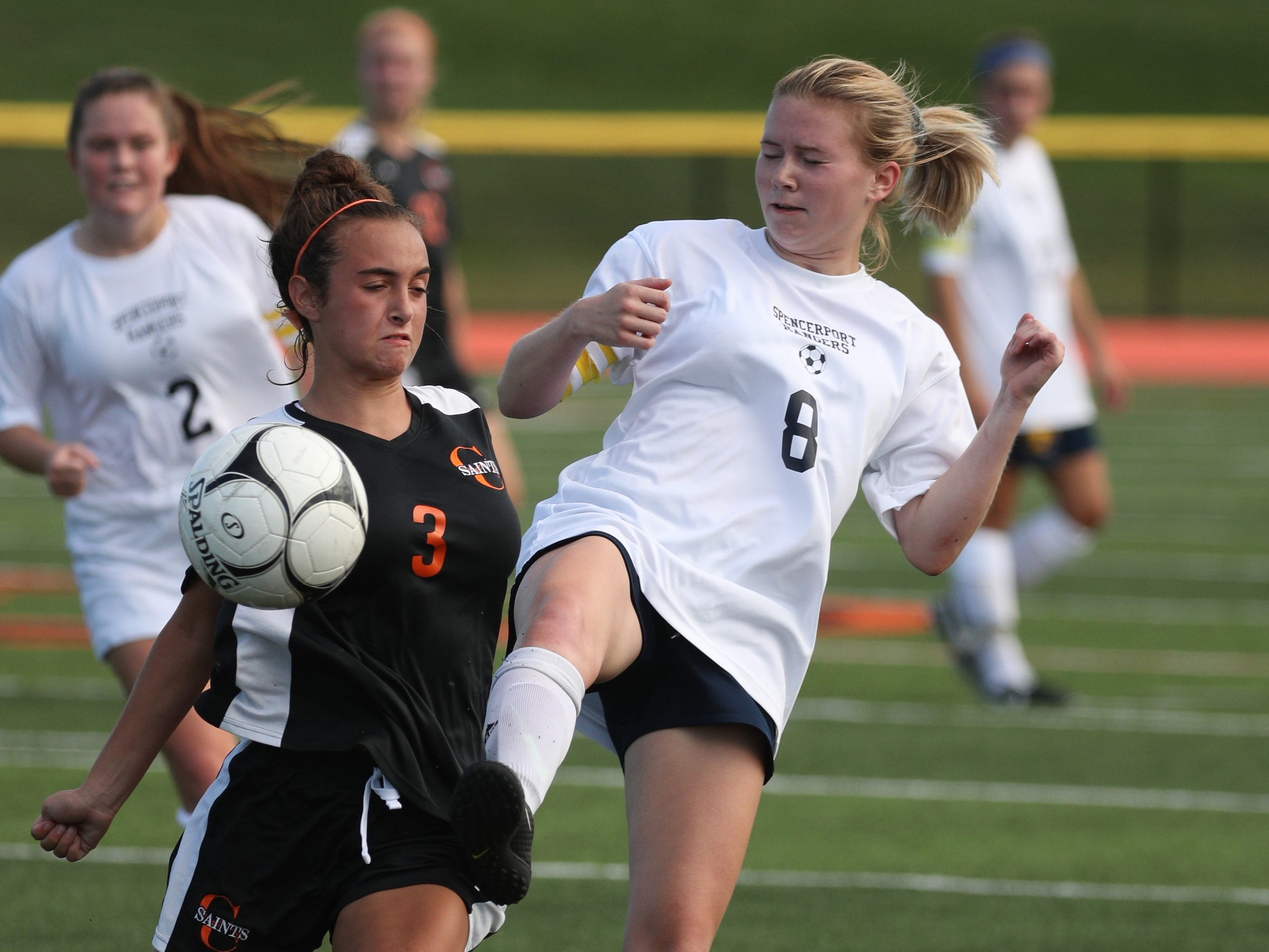Churchville-Chili's Angelica Reina and Spencerport's Leah Wengender (8) try to control the ball.