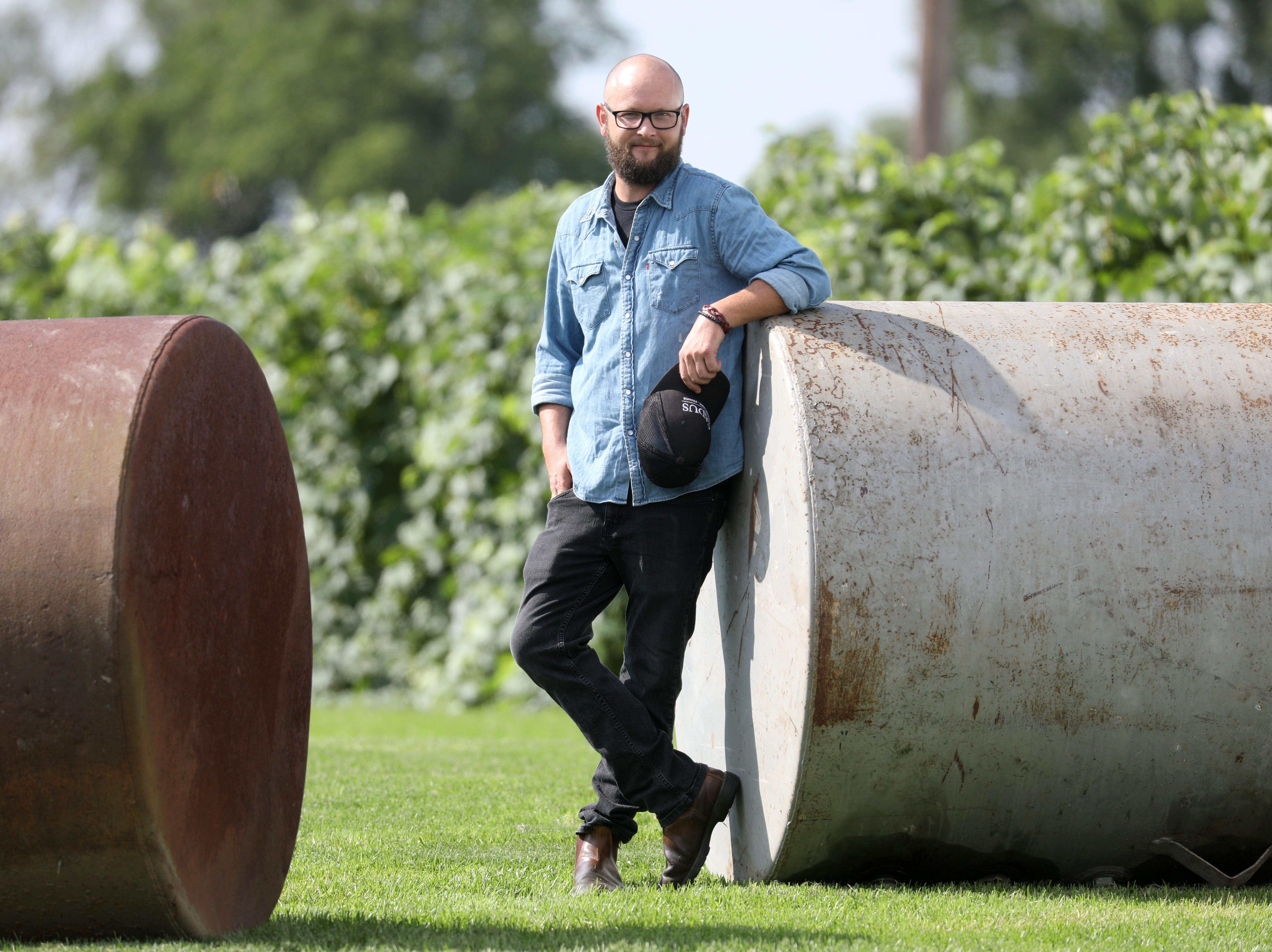Nathan Kendall, who owns Nathan K. Wines, pauses at Tuller Vineyards on Seneca Lake.