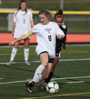 Spencerport's Leah Wengender carries the ball upfield against Churchville-Chili in a game earlier this season.