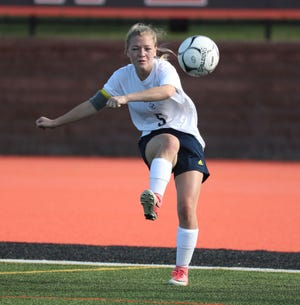 Spencerport's Medeline Carr clears the ball out of her end against Churchville-Chili.