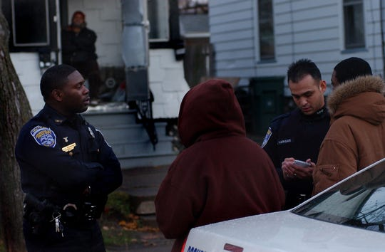 Mark Simmons,  left, in a 2007 file photo. He and another officer were speaking to witnesses after a robbery on Redwood Street.