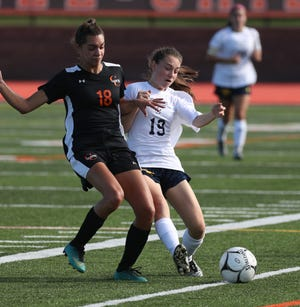 Churchville-Chili's Breanna Giacolone  and Spencerport's Lily Brongo fight for control of the ball.