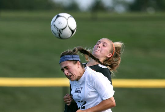 Spencerport's Olivia Wall gets a head on the ball in front of Churchville-Chili's Mya Mahon.