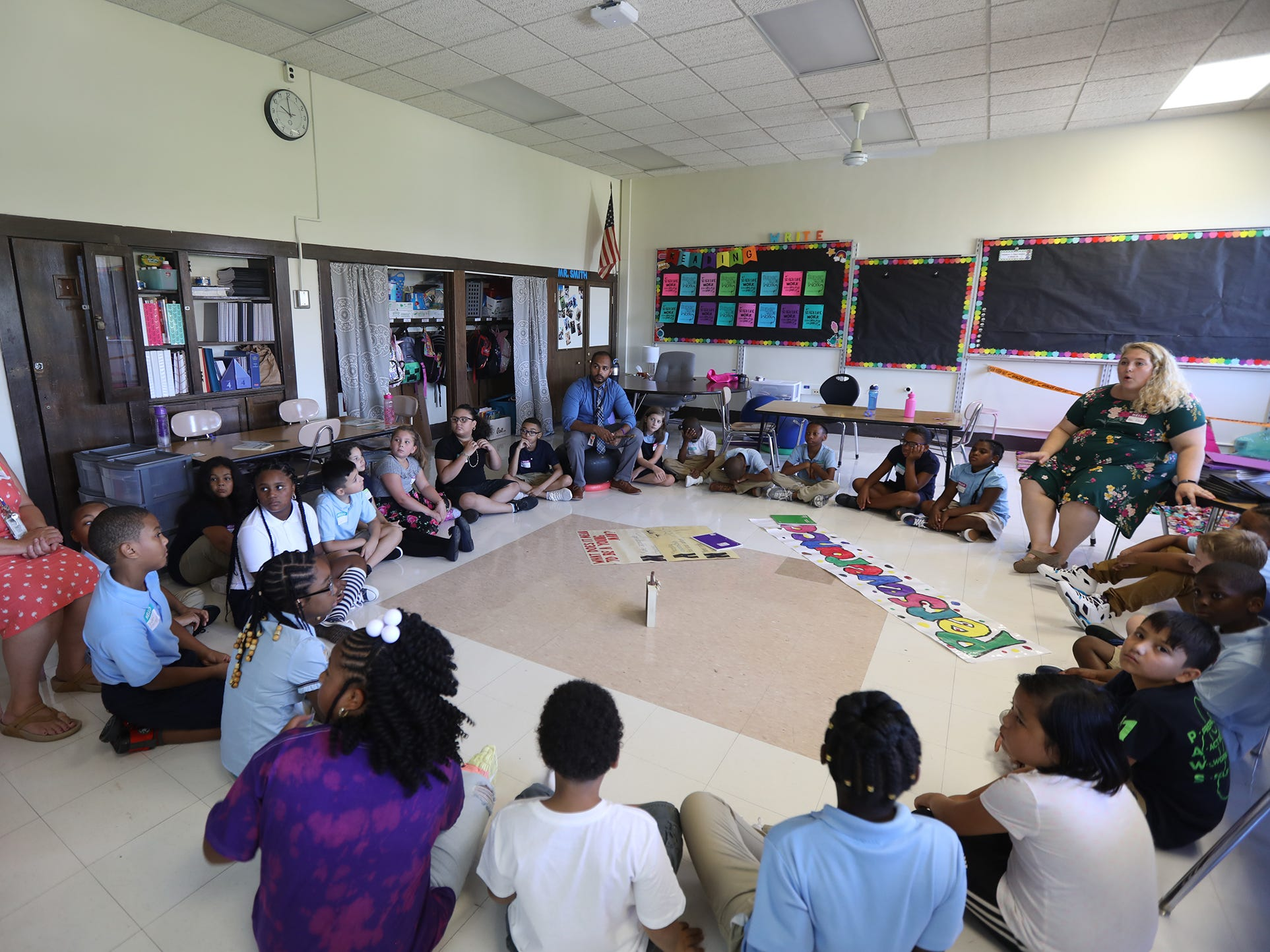 Three fourth-grade classes share a morning meeting at RISE Community School/Community School No. 106, formerly School 41, on their first day of school.  Morning meeting is a time for students and teachers to connect and get to know one another.
