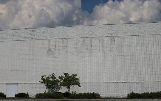 A light label scar on the outside is all that remains of the former Macy's department store, now sitting empty at Marketplace Mall in Henrietta Wednesday, Sept. 5, 2018.