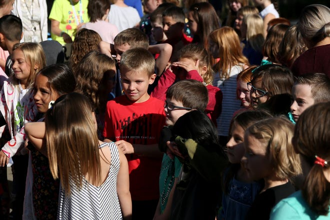 Students gather for the bell ringing ceremony on the first day of school for first through fifth graders at Brush College Elementary School in West Salem on Wednesday, Sep. 5, 2018.