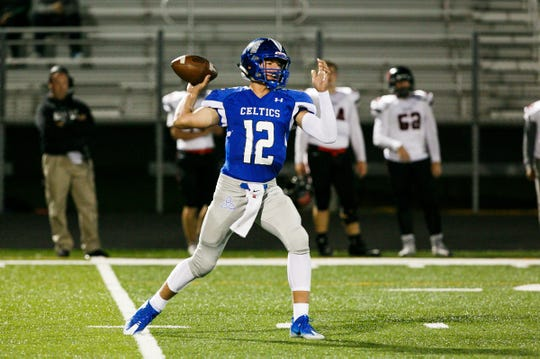 McNary's Erik Barker (12) throws a pass in a game against McMinnville on Friday, Oct. 6, 2017, at McNary High School in Keizer, Ore. McNary lost 39-35.
