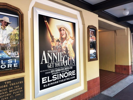 """An """"Annie Get Your Gun"""" poster outside of the Elsinore Theatre in Salem, Oregon, on Tuesday, Sept. 6."""