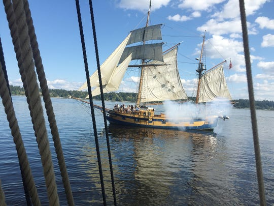 Smoke from the guns as the Hawaiian Chieftain, fires on the Lady Washington, as the two tall ships participate in a mock battle while on a cruise out of Olympia, Washington where they were participating in the annual Olympia Harbor Days September 1, 2018.