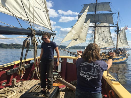Crew members aboard the Lady Washington taunt the crew and guests on the Hawaiian Chieftain as the two tall ships participate in a mock battle while on a cruise out of Olympia, Washington where they were participating in the annual Olympia Harbor Days September 1, 2018.