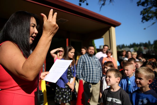 Principal Monica Takata speaks with students during a bell ringing ceremony on the first day of school for first through fifth graders at Brush College Elementary School in West Salem on Wednesday, Sep. 5, 2018.