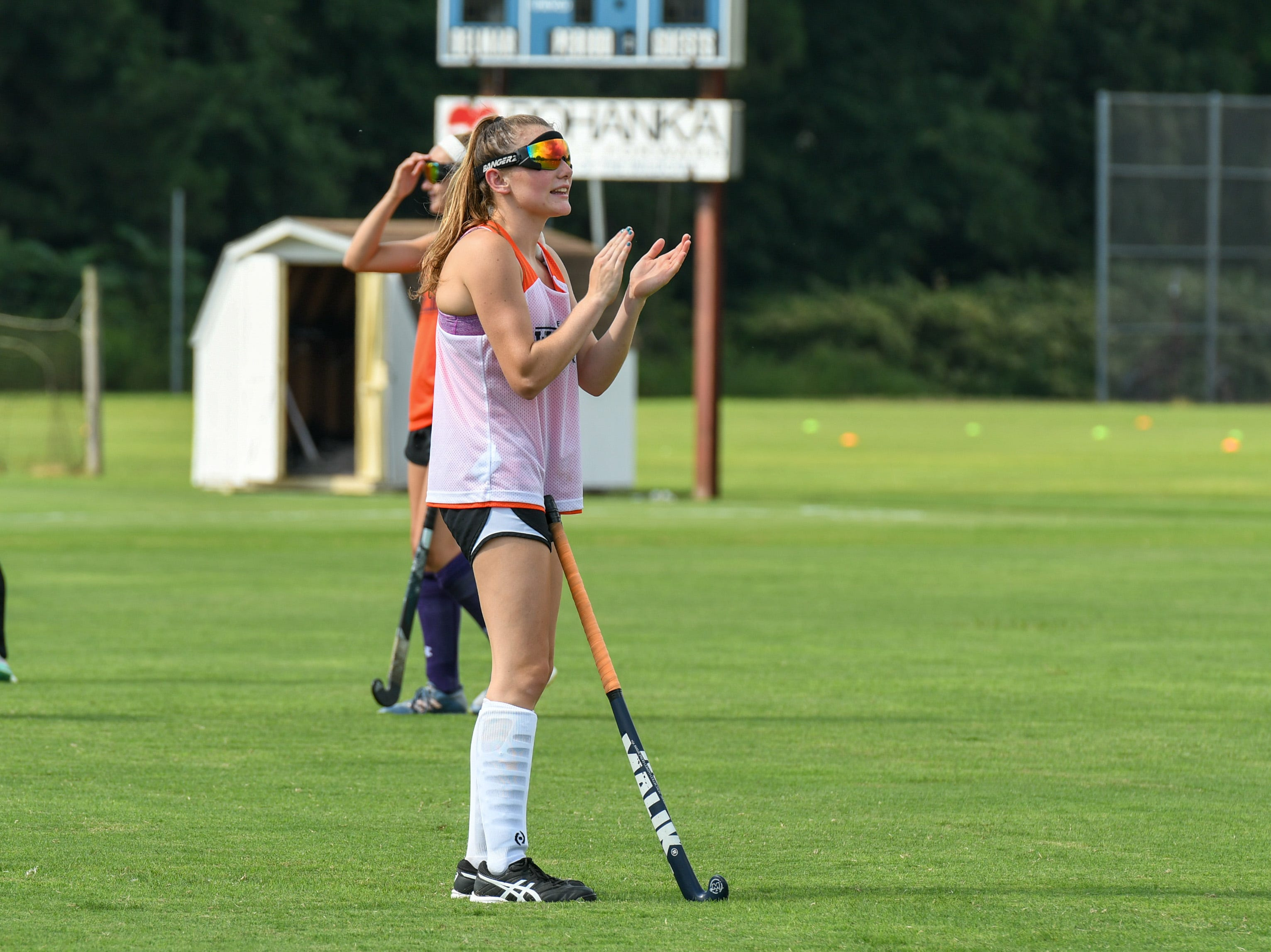 Senior Hailey Bitters cheers on her Delmar field hockey teammates at practice on Wednesday, Sept. 5.