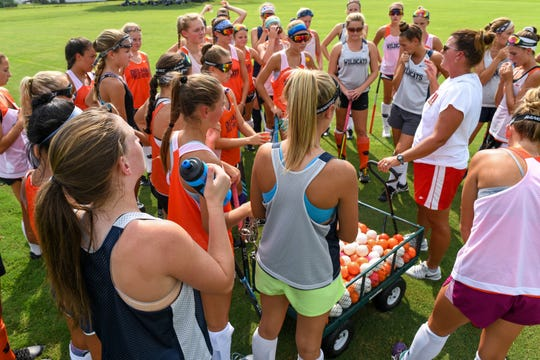 Coach Jodi Hollamon outlines the practice plan for the Delmar field hockey team on Wednesday, Sept. 5.