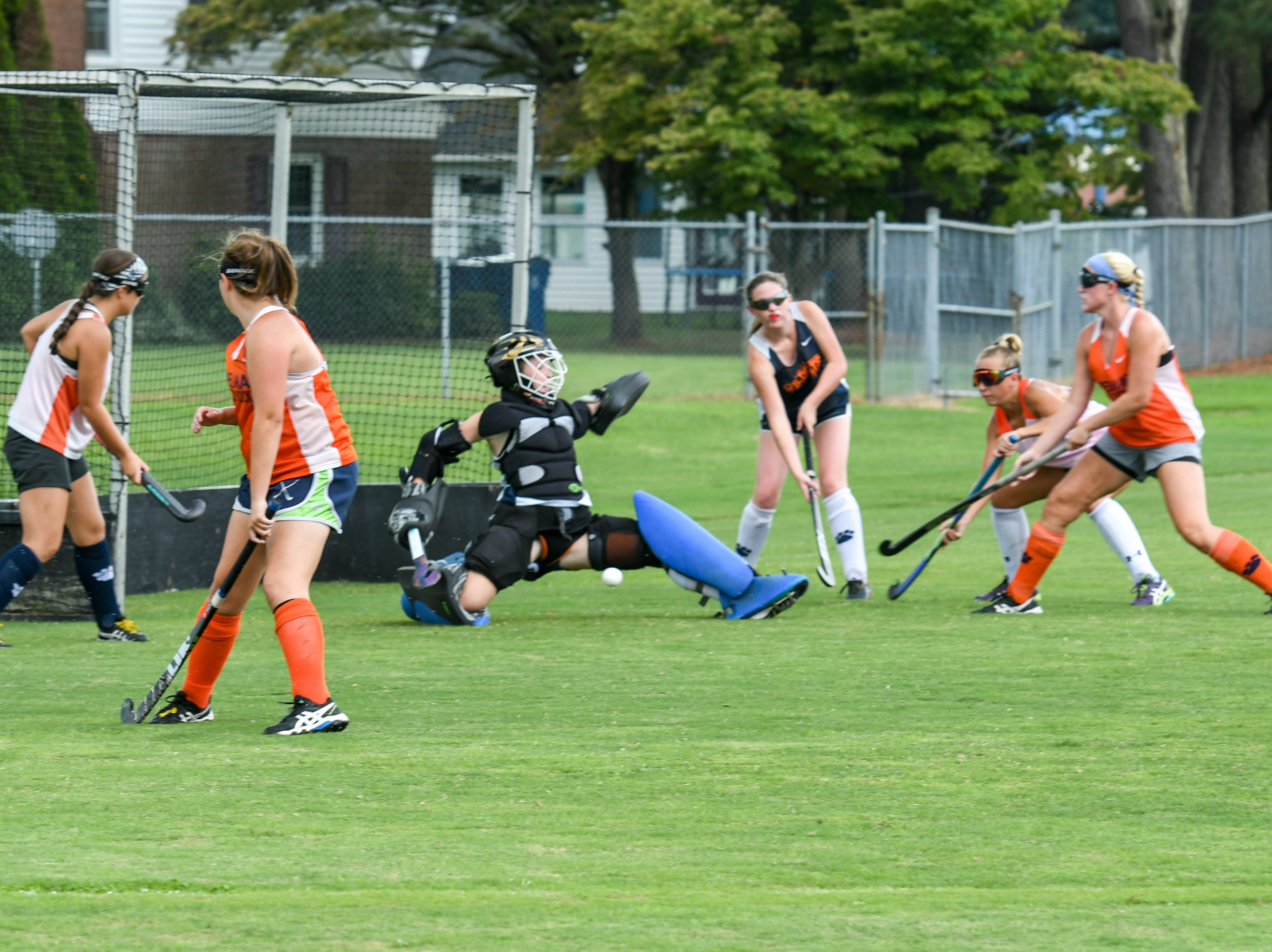Goalie Kelly Davis lunges to stop a shot during a scrimmage at Delmar field hockey practice on Wednesday, Sept. 5.