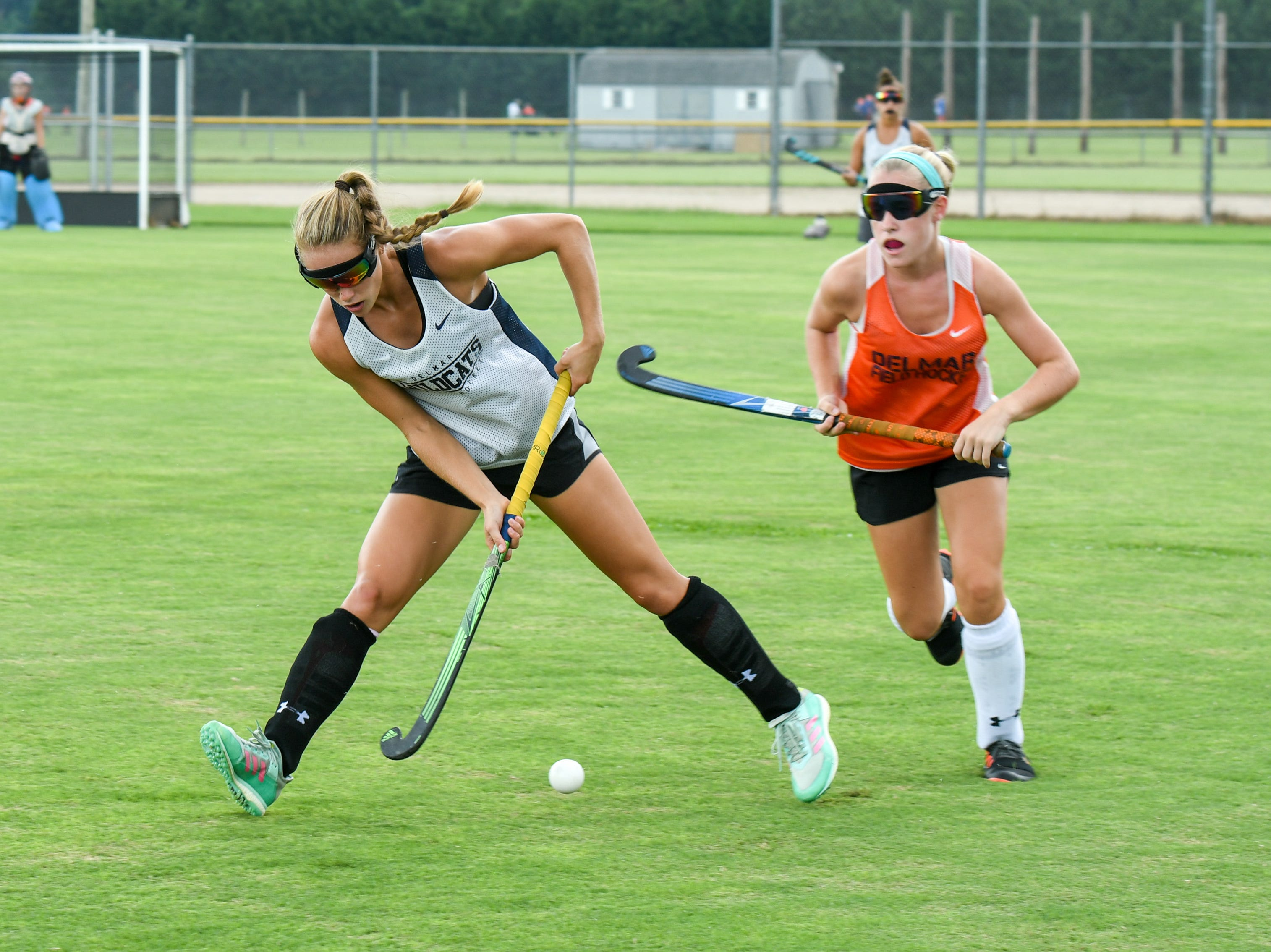 Senior Ashlyn Carr (left) hits the ball during a scrimmage at Delmar field hockey practice on Wednesday, Sept. 5.