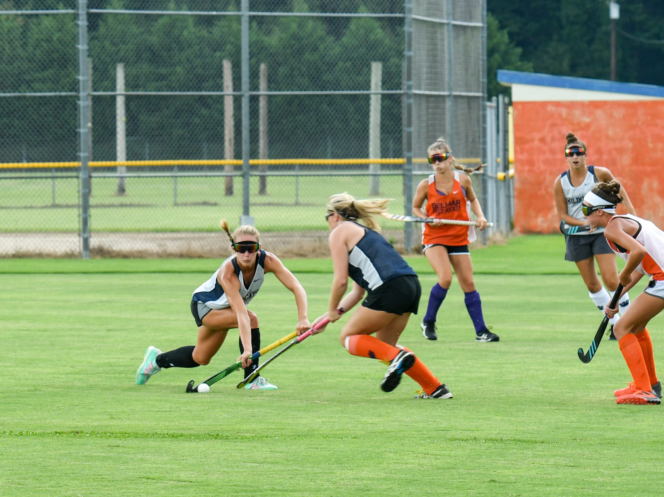 Senior Ashlyn Carr (left) fights for the ball during a scrimmage at Delmar field hockey practice on Wednesday, Sept. 5.