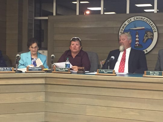 From left, council members Ellen Richardson and Denise Bowden and Mayor J. Arthur Leonard are shown at a Chincoteague Town Council meeting in this file photo.