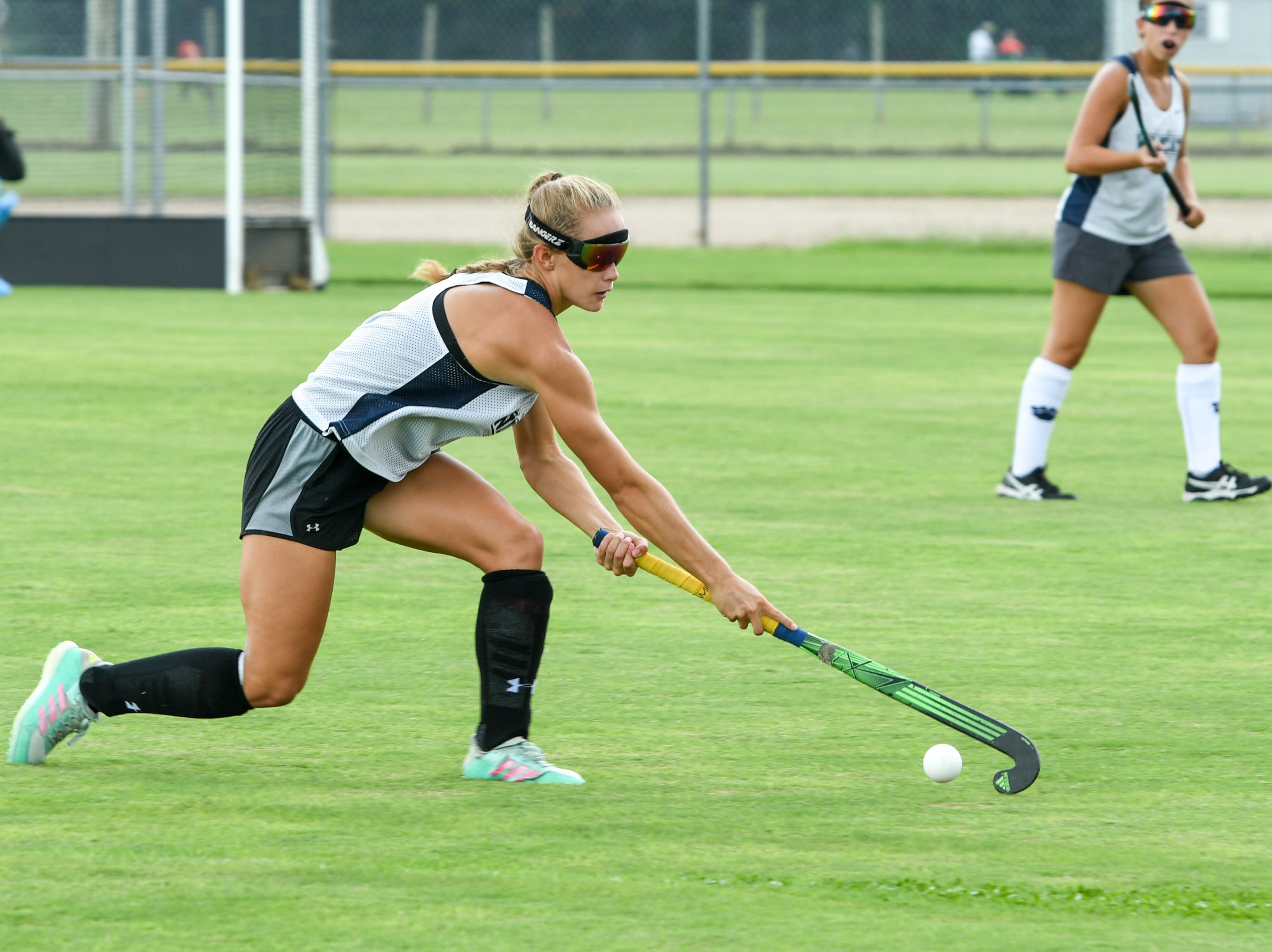Senior Ashlyn Carr reaches for the ball during a scrimmage at Delmar field hockey practice on Wednesday, Sept. 5.