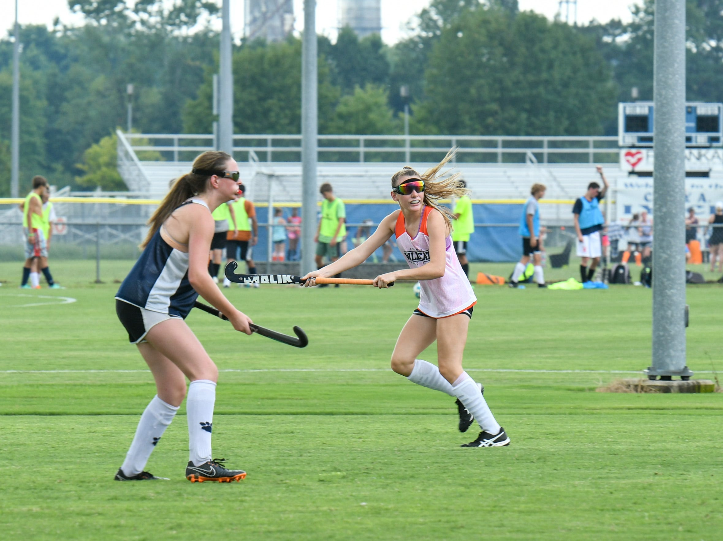 Senior Hailey Bitters (right) calls for the ball during a scrimmage at Delmar field hockey practice on Wednesday, Sept. 5.