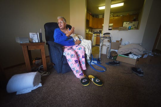 Deborah Burden talks about when she was sexually assaulted by a man while she was in a nursing home about four years ago Wednesday, Aug 29, at her home in Sioux Falls. Burden holds on tight to her chihuahua, Buddy. She said he has helped her deal with the trauma.