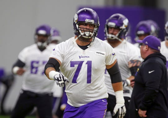 Minnesota Vikings tackle Riley Reiff (71) goes through calisthenics during practice at the NFL football team's training camp Wednesday, May 30, 2018, in Eagan, Minn. (AP Photo/Jim Mone)