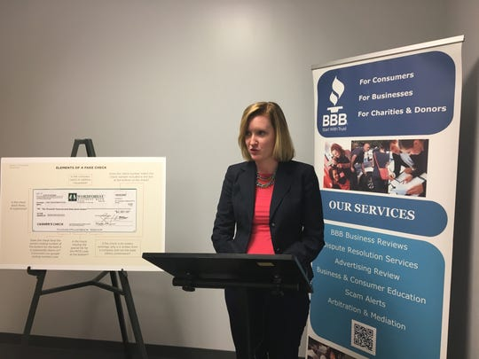 Stephanie Garland, Springfield regional director for the Better Business Bureau, delivers remarks about a BBB report on fake-check scams released Wednesday, Sept. 5, 2018.