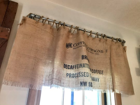 A custom curtain hangs in the new Crooked Hinges occasional shop in St. Joseph. The shop is set to open Oct. 11.