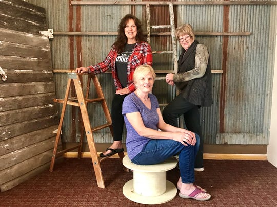 Co-owners Kim Reno, Jill Haak and Marilyn Hamblin are shown inside their new Crooked Hinges occasional shop in St. Joseph on Sept. 5.