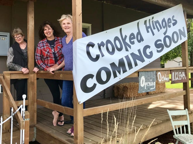Co-owners Marilyn Hamblin, Kim Reno and Jill Haak stand on the porch of their new Crooked Hinges occasional shop in St. Joseph on Sept. 5.