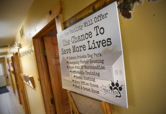 A sign outlines the benefits of a new facility at Grey Face Rescue Tuesday, Sept. 4, in west St. Cloud.