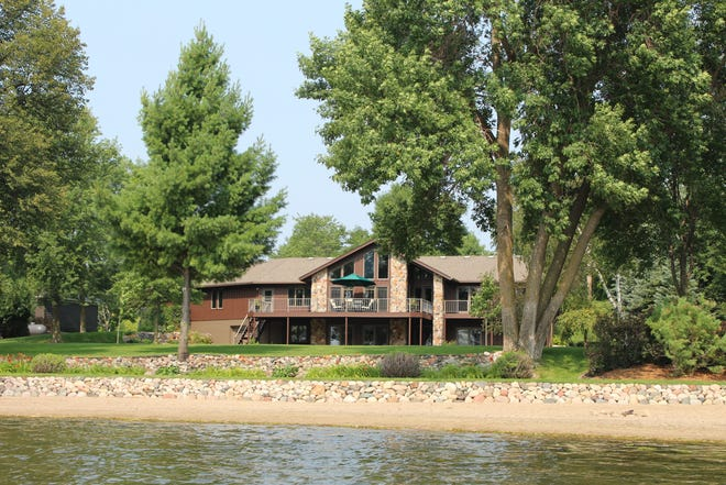 This home off Big Fish Lake features uninterrupted views of the waterfront.