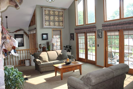 The wall of windows frames the living room on the lake side.