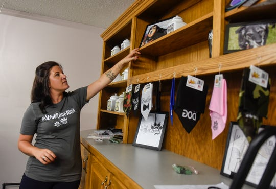 Bethie Gondeck talks about the inspiration for Grey Face Rescue during a tour of the new facility Tuesday, Sept. 4, in west St. Cloud.