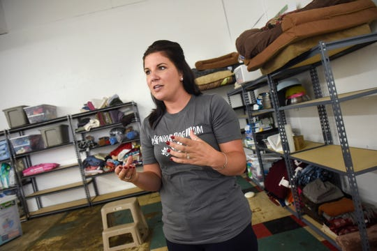 Bethie Gondeck talks about the mission of Grey Face Rescue in the indoor dog park area of the new facility Tuesday, Sept. 4, in west St. Cloud.